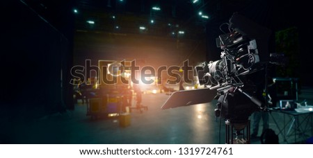 Behind the scenes of making of movie and TV commercial. Camera of movie and video production. Film Crew. B-roll, and crew team in studio and set on dark background #1319724761