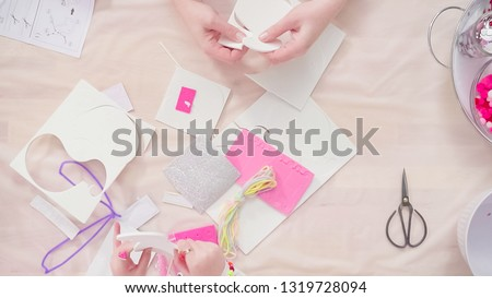 Flat lay. Step by step. Mother and daughter making unicorn craft from paper foam. #1319728094