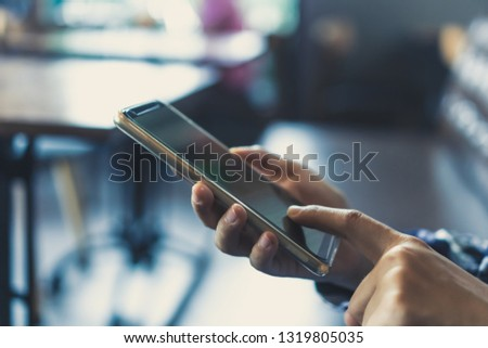 Woman hand using smartphone in cafe shop background. Business, financial, trade stock maket and social network concept. #1319805035