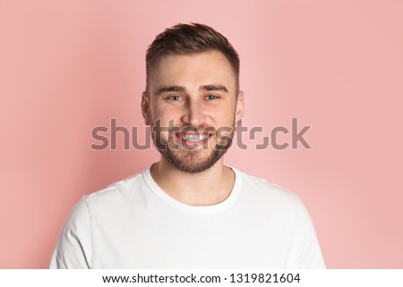 Young man with healthy teeth on color background #1319821604