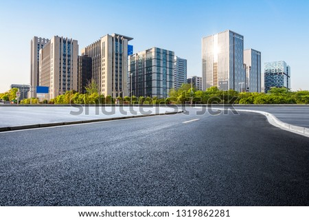 Panoramic skyline and modern business office buildings with empty road,empty concrete square floor #1319862281