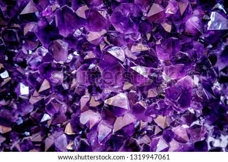 Amethyst purple crystal. Mineral crystals in the natural environment. Texture of precious and semiprecious gemstone. #1319947061