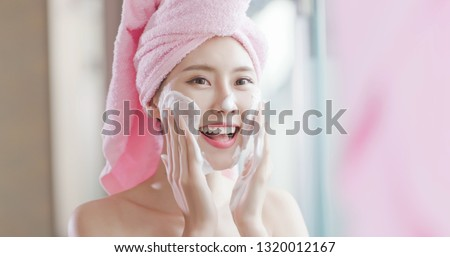 woman wash her face in the bathroom after shower #1320012167