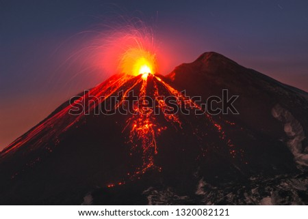 Incredible view of Volcano Etna during an eruption. Sud-Est crater at sunset, best colors, lava fountain #1320082121