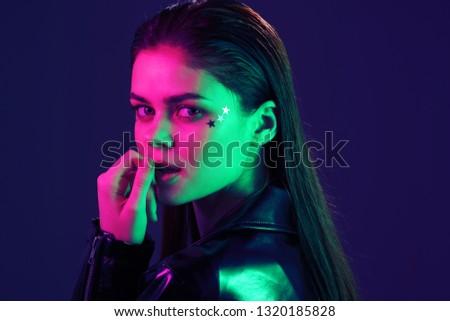 Cute glamorous woman in fashionable clothes neon nightclub dancing #1320185828