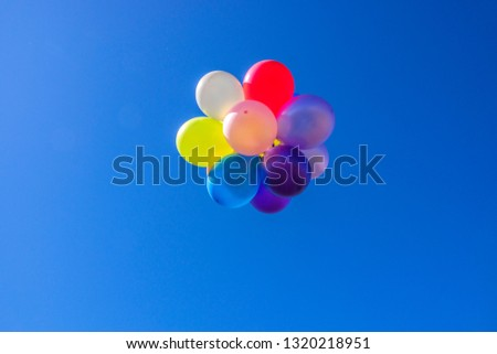 Multi-colored balloons background that floats in the air on bright days #1320218951