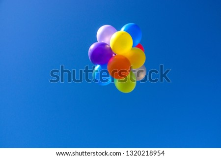 Multi-colored balloons background that floats in the air on bright days #1320218954