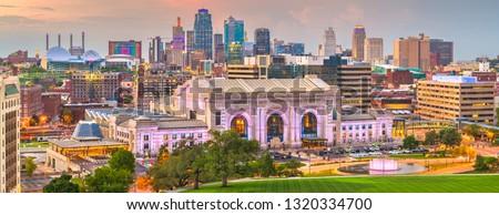 Kansas City, Missouri, USA downtown skyline panorama at dusk.