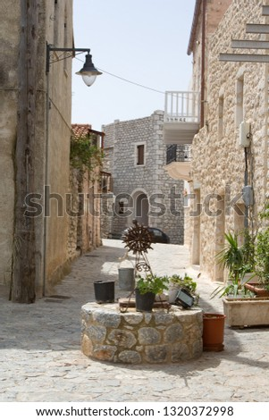 Old greek stone street view  #1320372998