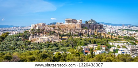 Panorama of Athens with Acropolis hill, Greece. Famous old Acropolis is a top landmark of Athens. Ancient Greek ruins in the Athens center in summer. Scenic view of remains of antique Athens city. #1320436307