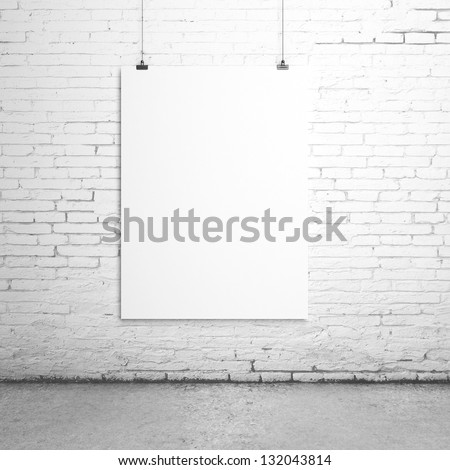 white blank paper clips on brick room