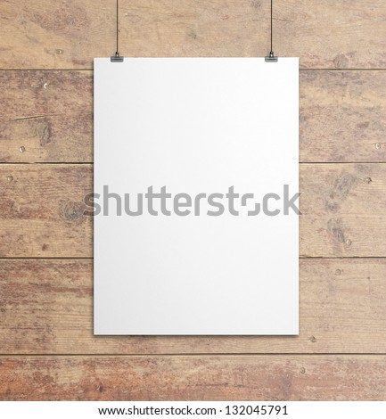 white paper clips and wood background
