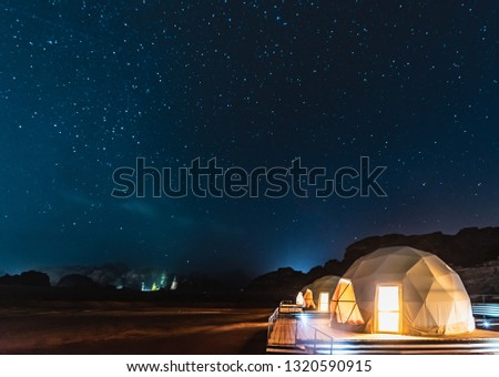 Stars above martian dome tents in Wadi Rum Desert, Jordan. #1320590915