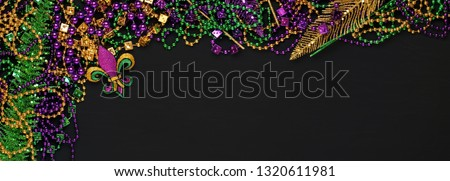 Purple, Gold, and Green Mardi Gras beads and decorations background