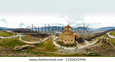 Jvari Monastery Drone Panorama with tourists and visitors during a cloudy day in Mtskheta, Georgia #1320642446