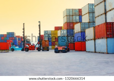 Forklift container loading and unloading cargo into the import-export zone #1320666314