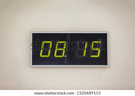 Black digital clock on a white background showing time 08.15 minutes #1320689153