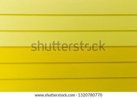 Wood yellow background.yellow Synthetic wood wall texture use for background.Colorful wooden board painted in yellow. Wood background #1320780770