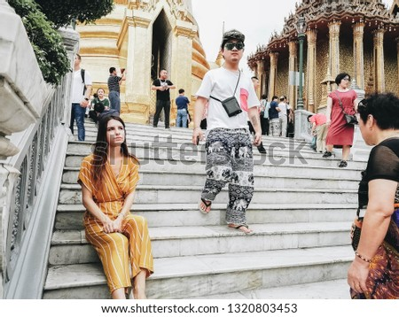 Bangkok / Thailand - 12.12.2018: Girl against the background of the Royal Palace in Bangkok. #1320803453
