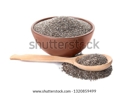 Bowl and spoon with chia seeds isolated on white #1320859499