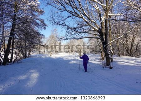 Skier in the winter forest. Ski walk. Beautiful winter day. #1320866993