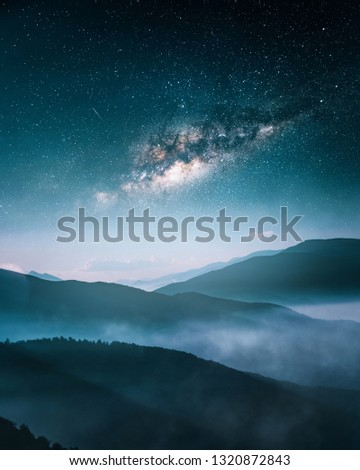 Milkyway over foggy mountains #1320872843