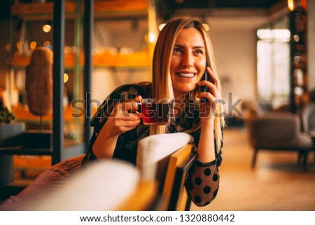 Urban Blonde Woman Talking on Smartphone at Cafe #1320880442