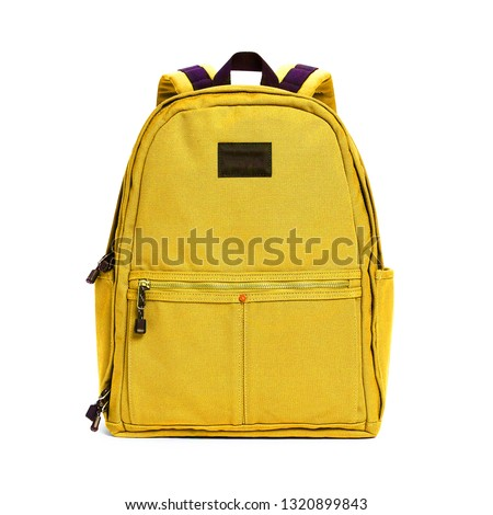 Backpack Isolated on White Background. Yellow Travel Daypack with Zippered Compartment. Satchel Rucksack. Canvas School Backpack. Bag Front View with Shoulder Straps #1320899843
