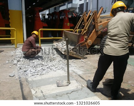 KUALA LUMPUR, MALAYSIA FEBRUARY, 23 2019 : Breaking work and cleaning concrete floors using heavy machinery #1321026605
