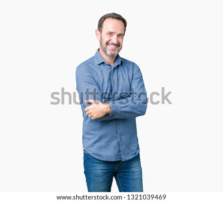 Handsome middle age elegant senior man over isolated background happy face smiling with crossed arms looking at the camera. Positive person. #1321039469