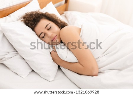 Sweet dream. Happy woman sleeping, wraping herself up in bed, closeup #1321069928