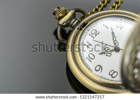 Time management concept : Vintage / retro pocket watch / clock on black table, depicts process of planning, exercising conscious control of time to increase effectiveness, efficiency and productivity #1321147217