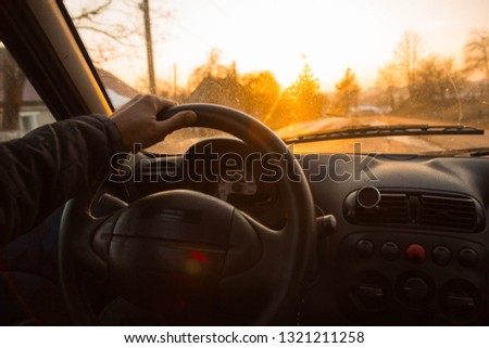 driving a driver on a sunny day. bright sunset from the window.  #1321211258