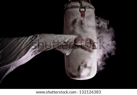 Karate round kick in a punching bag Royalty-Free Stock Photo #132126383