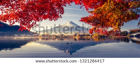 Colorful Autumn Season and Mountain Fuji with morning fog and red leaves at lake Kawaguchiko is one of the best places in Japan #1321286417