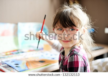 Cute little girl painting a picture in home studio #132132113