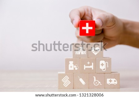 Health Insurance Concept,hand arranging wood block stacking with icon healthcare medical,for health. #1321328006