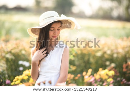 Beautiful girl and flowers field. #1321349219