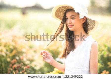 Beautiful girl and flowers field. #1321349222