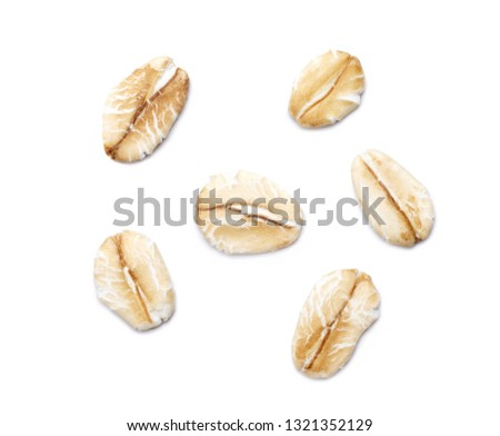 A pile of oat-flakes isolated on white background. Close up. #1321352129