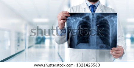 Doctor looking chest x-ray #1321425560