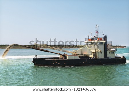 Dredge boat removing sand and silt from the bottom. Dredger ship works.Pumping sand. #1321436576