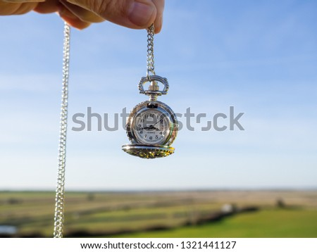 One person with one antique chain watch plated in his hand #1321441127
