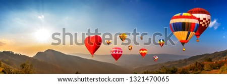 Panorama of colorful hot air balloon fly over mountain view with sunlight,  blue sky and white cloud at  Chiangrai, Thailand #1321470065