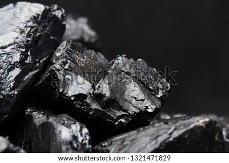 Natural coal on a black background isolated closeup. Extraction of natural mineral resources. #1321471829