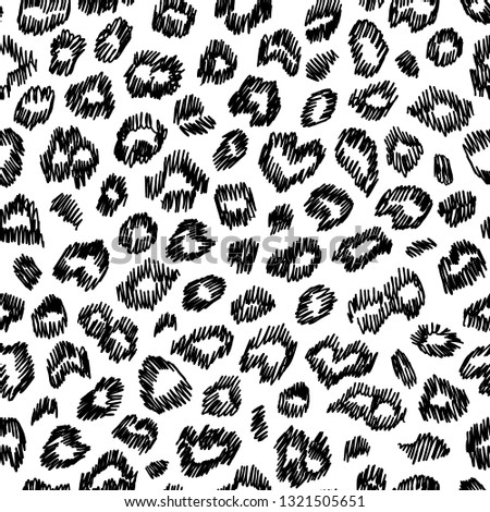 Leopard hand drawn seamless pattern. Perfect for textile. Black spots on white background. #1321505651