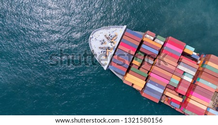 Aerial of cargo ship carrying container and running for export  goods  from  cargo yard port to other ocean concept freight shipping ship on blue sea , logistic service transportation. #1321580156
