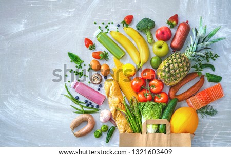 Healthy food selection. Shopping bag with groceries full of fresh vegetables and fruits #1321603409