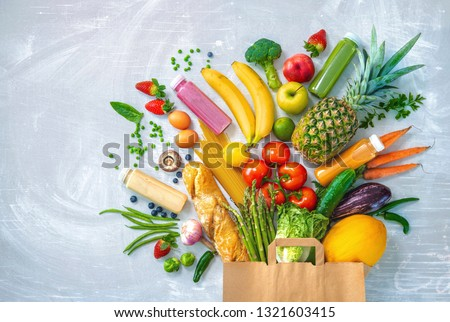 Healthy food selection. Shopping bag with groceries full of fresh vegetables and fruits #1321603415