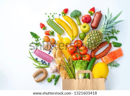 Healthy food selection. Shopping bag with groceries full of fresh vegetables and fruits #1321603418
